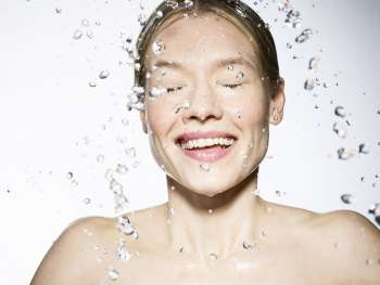 Young Caucasian female with water splashes